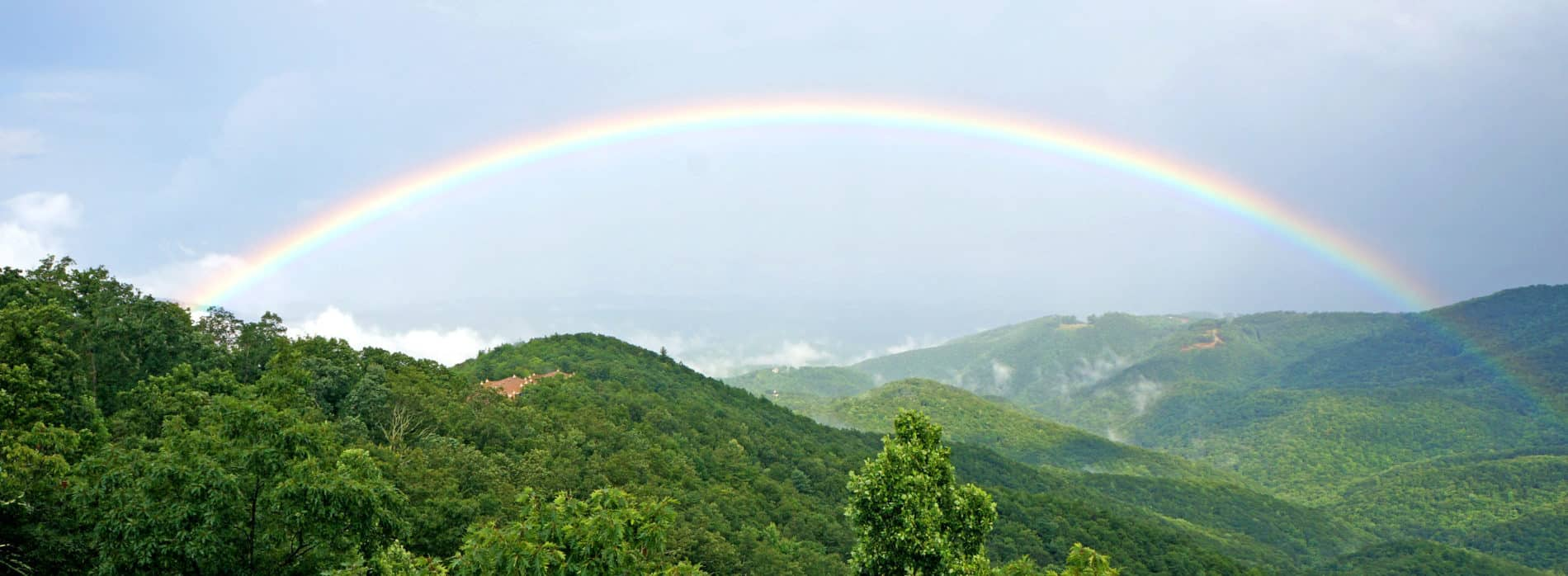 rainbow over valley at Art of Living Retreat Center