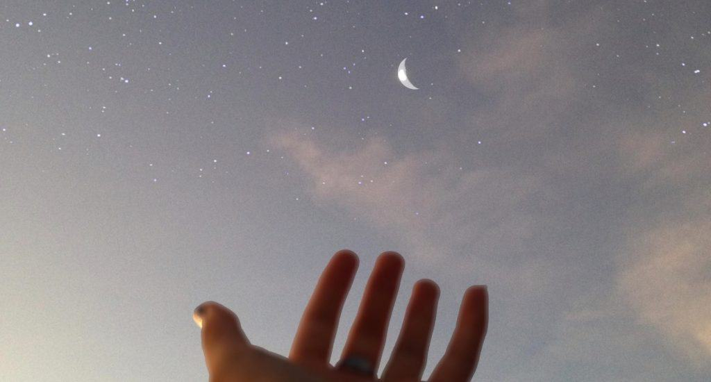 hand and moon